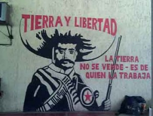 """Another mural, at Agua Clara, shows Emeliano Zapata and proclaims; """"The land is not for sale - it is of those who work it"""""""