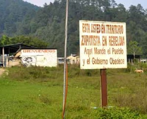 """The Zapatistas mark their territory with defiant signs such as this one; """"Here the people demand and the government obeys"""""""